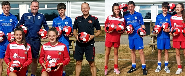 Footballs Donated To Local Teams from Proudfoot and Coca Cola